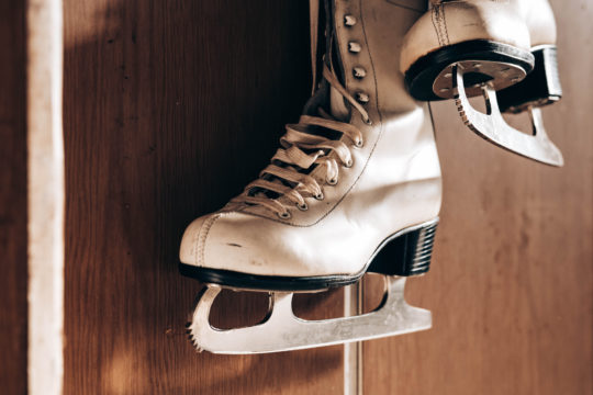 Old retro skates hanging on the wall